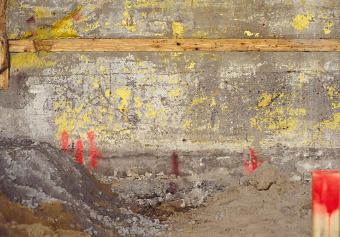 Cement wall with red stake, from the Zone series, Montréal, archival ink jet print on Arches paper (26x41 inches), 1997